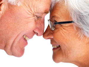 Closeup cropped image of a happy retired couple face to face , looking at eachother